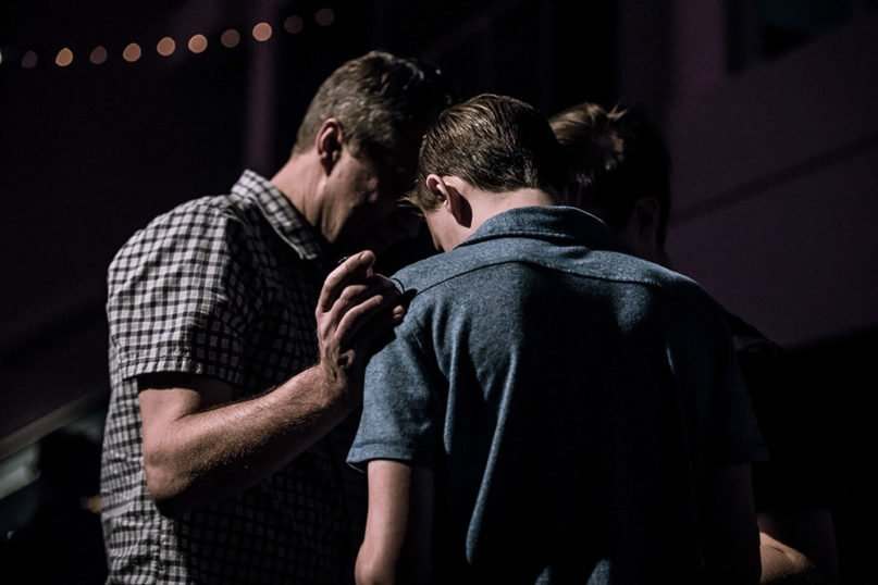 A group prays together. Photo by Jack Sharp/Unsplash/Creative Commons