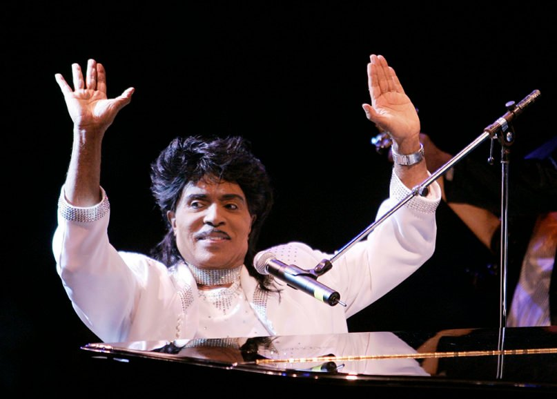 """In this Aug. 19, 2004, file photo, Little Richard performs at Westbury Music Fair in Westbury, N.Y.  Little Richard, the self-proclaimed """"architect of rock-n-roll"""" whose piercing wail, pounding piano and towering pompadour irrevocably altered popular music while introducing black R&B to white America, died Saturday, May 9, 2020. (AP Photo/Ed Betz)"""