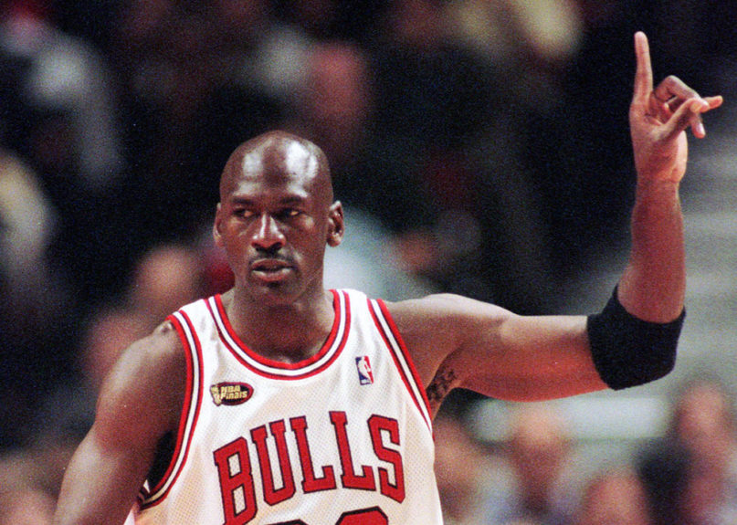 Chicago Bulls guard Michael Jordan signals to his teammates during the first quarter of Game 5 of the NBA finals in Chicago on June 12, 1998. (AP Photo/Beth A. Keiser)