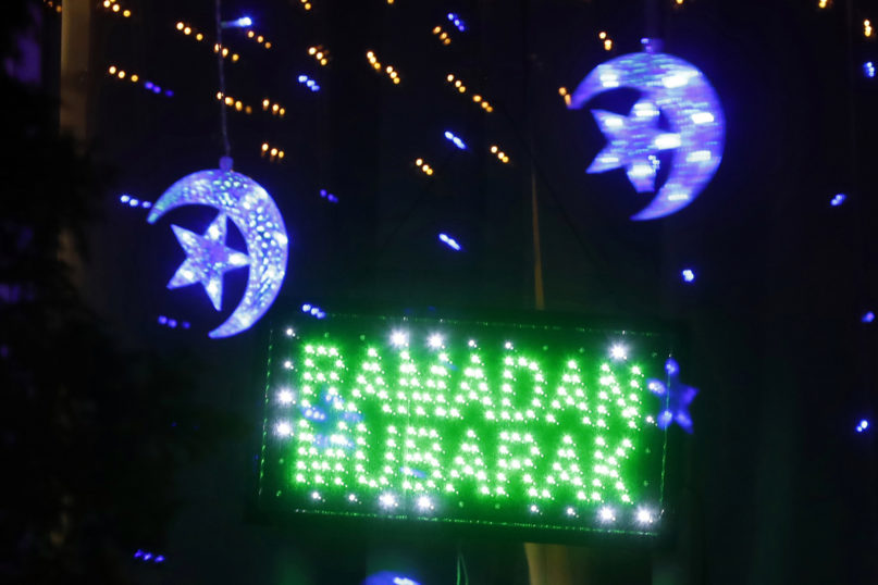 In this April 28, 2020 photo, Ramadan lights are displayed on a house in Dearborn, Michigan. The Muslim community in Dearborn is hosting a Ramadan lights competition in hopes of spreading joy and bringing back some of the holiday spirit during the coronavirus pandemic. (AP Photo/Carlos Osorio)
