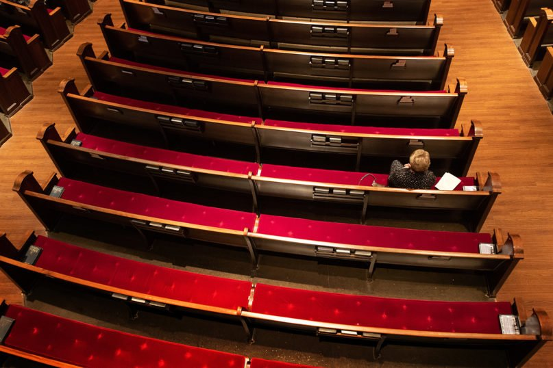Susan Logan worships in an empty pew section at Belmont United Methodist Church in Nashville, Tenn., Sunday, March 15, 2020, after church leadership encouraged people to worship from home via video livestream in response to the coronavirus. Photo by Mike DuBose/UM News