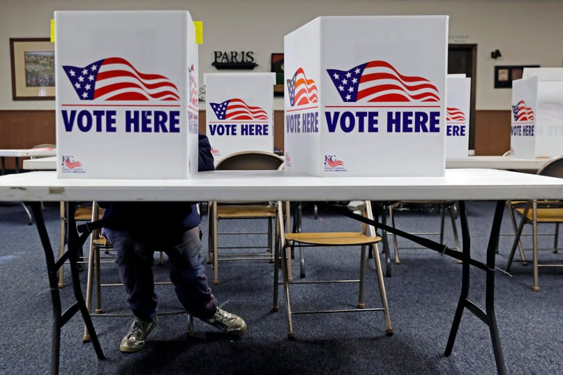 A voter completes a ballot in the presidential primary election at the Summit View Church of the Nazarene on March 10, 2020, in Kansas City, Missouri. (AP Photo/Charlie Riedel)