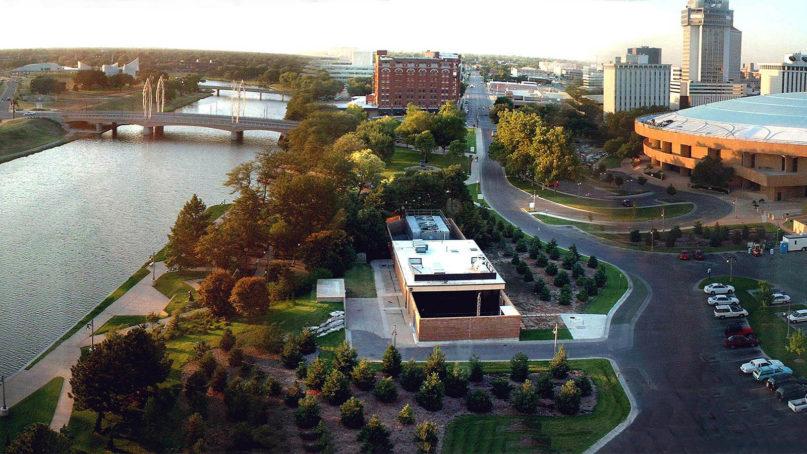 The Arkansas River flows through downtown Wichita, Kansas. Photo by Hugh Mason/Creative Commons