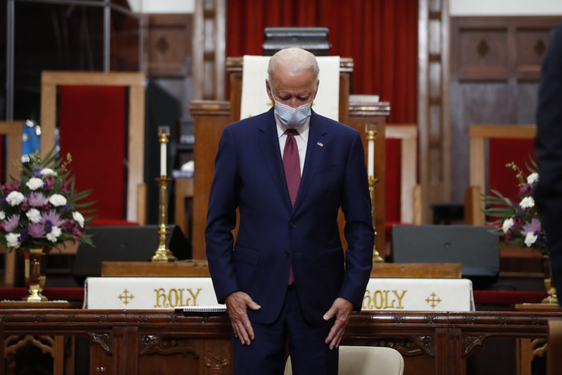 Democratic presidential candidate former Vice President Joe Biden bows his head in prayer during a visit to Bethel AME Church in Wilmington, Delaware, on  June 1, 2020. (AP Photo/Andrew Harnik)