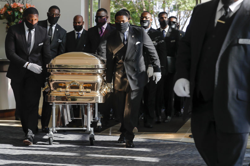 Pallbearers bring the coffin into The Fountain of Praise church in Houston for the funeral for George Floyd on Tuesday, June 9, 2020. Floyd died after being restrained by Minneapolis Police officers on May 25. (Godofredo A. Vásquez/Houston Chronicle via AP, Pool)