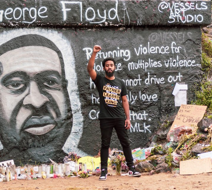 Pastor Tyler Burns at a George Floyd mural and memorial in Pensacola, Florida. Photo by Max Petion
