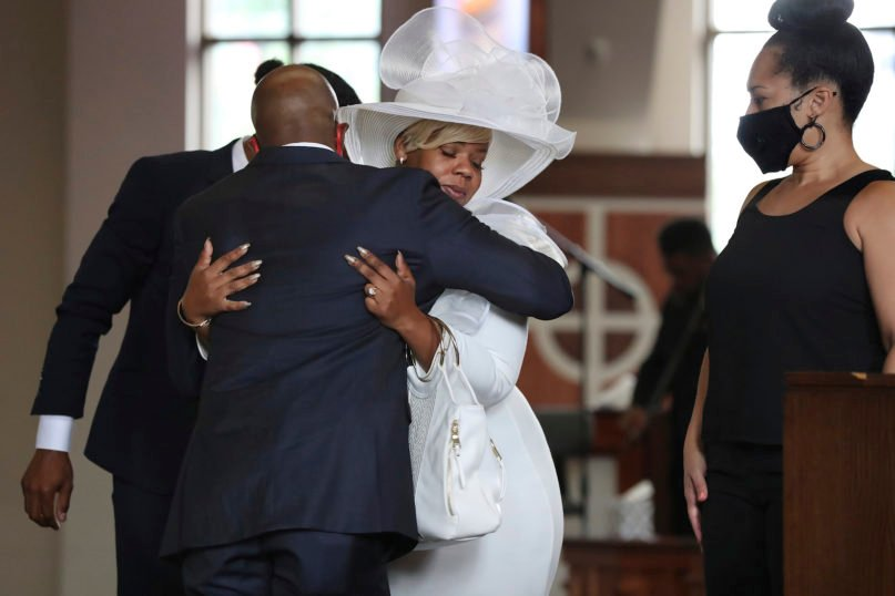 The Rev. Raphael G. Warnock, senior pastor of Ebenezer Baptist Church, comforts Tomika Miller, the wife of Rayshard Brooks, during his public viewing at Ebenezer Baptist Church on June 22, 2020, in Atlanta. Brooks, 27, died June 12 after being shot by an officer in a Wendy's parking lot. Brooks' death sparked protests in Atlanta and around the country. A private funeral for Brooks will be held Tuesday at the church. (Curtis Compton/Atlanta Journal-Constitution via AP, Pool)