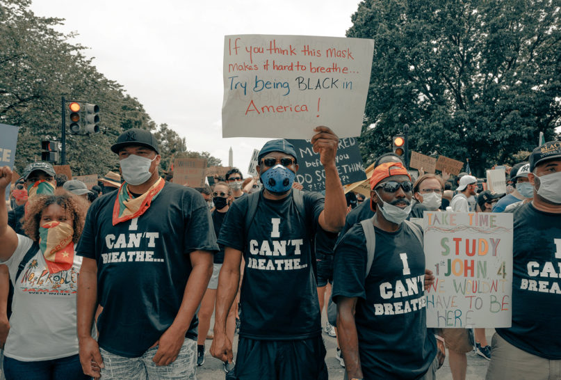 Demonstrators hold signs and wear shirts about breathing while protesting against racial injustice in Washington, D.C., on June 6, 2020. Photo by Clay Banks/Unsplash/Creative Commons
