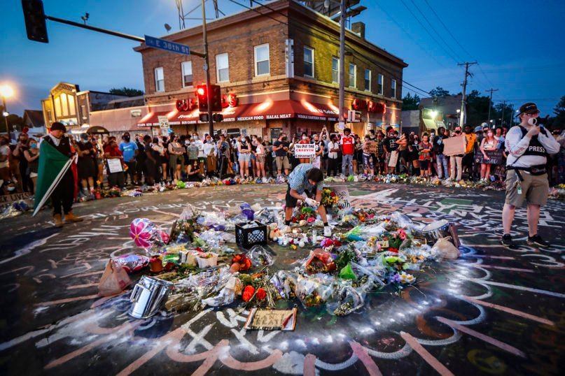 Protesters gather June 1, 2020, at a memorial for George Floyd where he died outside Cup Foods on East 38th Street and Chicago Avenue in Minneapolis. Protests have continued since his death after being restrained by Minneapolis police officers on May 25. (AP Photo/John Minchillo)
