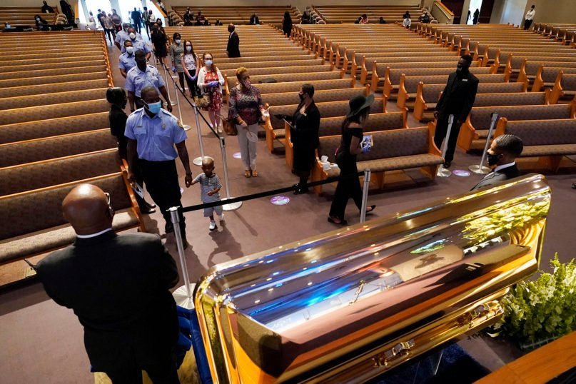 Mourners pass by the casket of George Floyd during a public visitation for him at the Fountain of Praise church June 8, 2020, in Houston. (AP Photo/David J. Phillip, Pool)