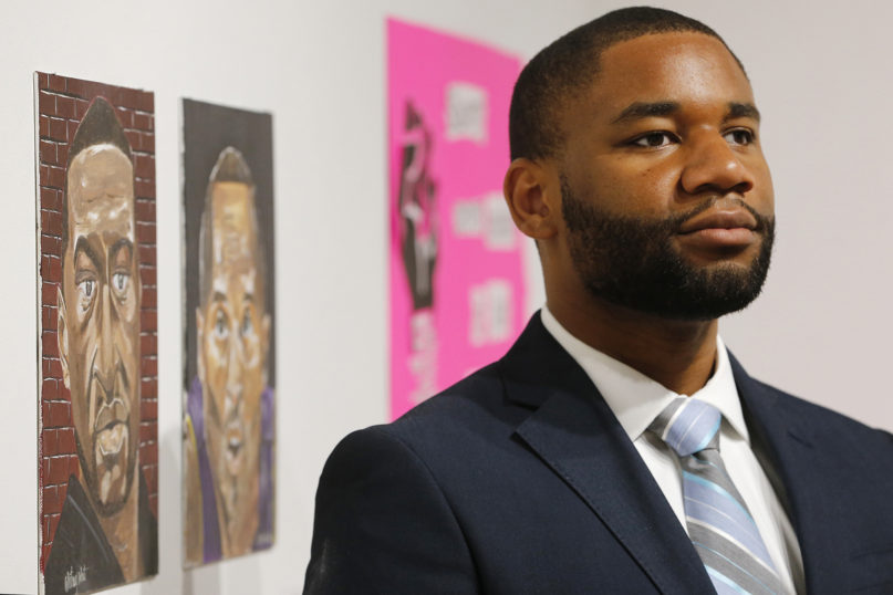 Liberty University's former director of diversity retention, LeeQuan McLaurin, poses for a portrait at the Black history exhibit at the Academy Center of the Arts in Lynchburg, Virginia, on June 17, 2020. McLauren, a Liberty alumnus, left his job in the wake of a tweet from Jerry Falwell Jr., the university's president, which invoked the blackface scandal that engulfed Virginia's governor last year. Falwell's apology for that tweet has done little to convince his critics that the school's culture is as welcoming as it contends. (AP Photo/Steve Helber)
