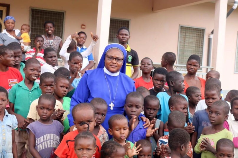 Sister Stan Therese Mario Mumuni, center, poses with children she works with in Ghana. Photo by Doreen Ajiambo/Global Sisters Report