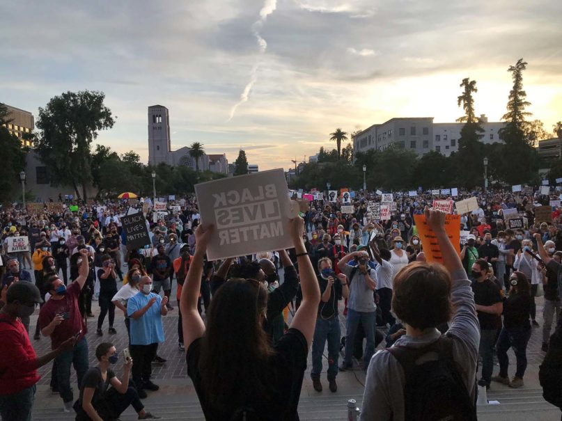People gather for an evening vigil against police brutality and in support of Black Lives Matter in Pasadena, California, Sunday, May 31, 2020. RNS photo by Alejandra Molina