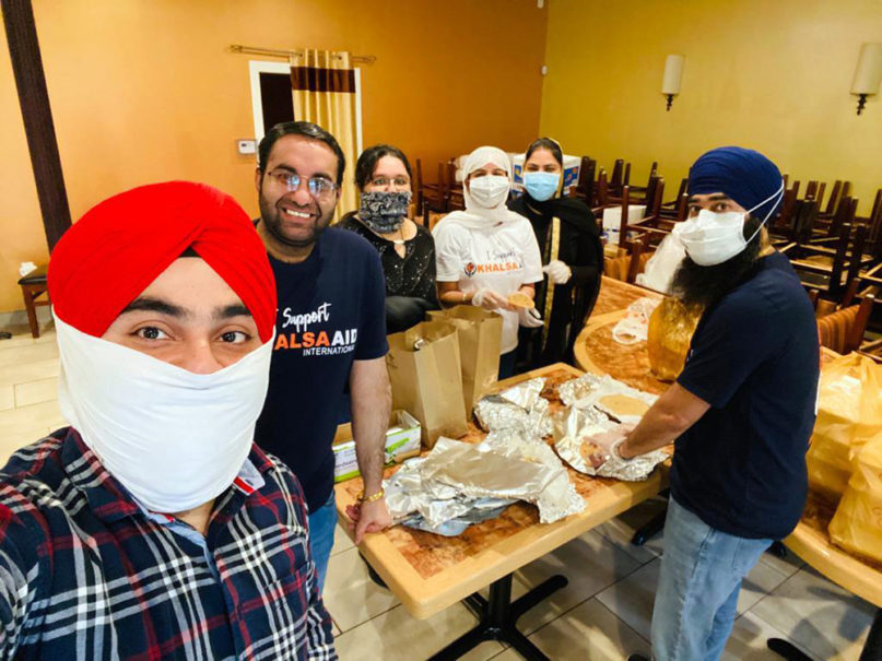 Khalsa Aid volunteers cook, pack and distribute meals for health workers at Cooper University Hospital in Camden, New Jersey. Photo courtesy of Amritpal Kaur