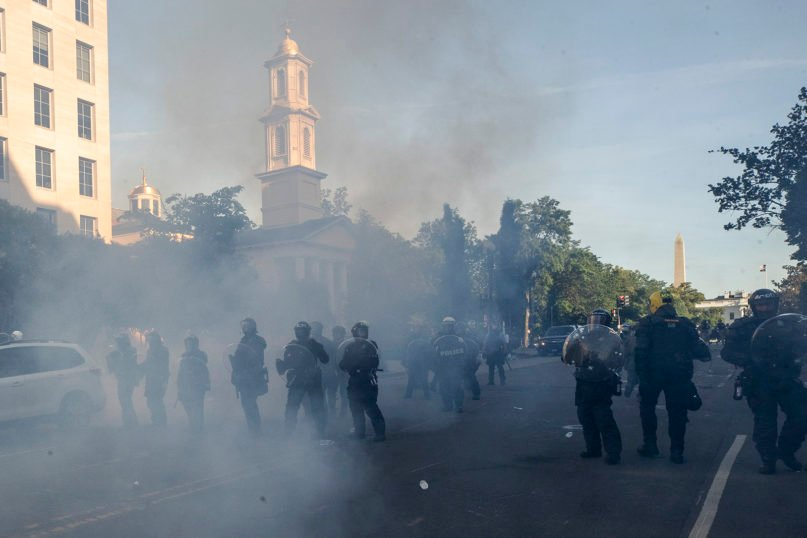 Tear gas floats in the air June 1, 2020, as police move demonstrators away from St. John's Church, across Lafayette Park from the White House in Washington, as they protest the death of George Floyd. (AP Photo/Alex Brandon)