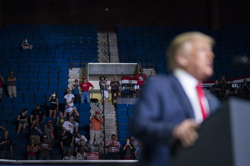 President Donald Trump speaks to a smaller than anticipated crowd during a campaign rally at the BOK Center on June 20, 2020, in Tulsa, Oklahoma. (AP Photo/Evan Vucci)