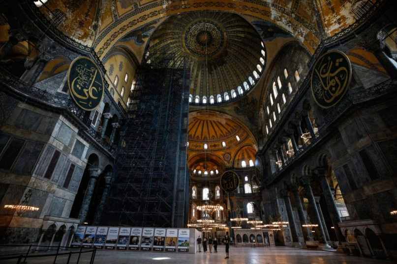 People visit the Byzantine-era Hagia Sophia, one of Istanbul's main tourist attractions in the historic Sultanahmet district of Istanbul, on June 25, 2020. Turkey's highest administrative court on July 2, 2020, began considering a request for the UNESCO World Heritage site that now serves as a museum to be reverted back into a mosque. (AP Photo/Emrah Gurel)