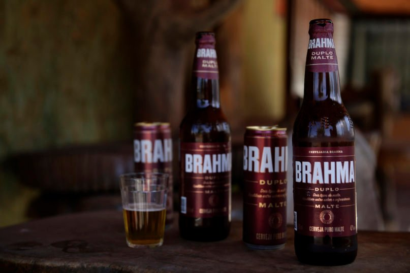 Brahma beer is displayed at a bar that's open for deliveries only amid the COVID-19 pandemic in Brasilia, Brazil, on July 14, 2020. An interfaith coalition is pressuring the world's largest brewer to remove the name of the Hindu god, saying the name is offensive to Hindus, who worship Lord Brahma, the religion's god of creation. An Anheuser-Busch InBev brewery spokesman says the beer actually was named to honor Joseph Bramah, an Englishman who invented the draft pump handle, and the spelling was changed to adapt the name to the Portuguese language. (AP Photo/Eraldo Peres)