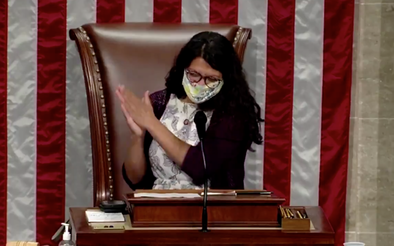 Rep. Rashida Tlaib claps in celebration on July 22, 2020, after the House of Representatives voted 233-183 to repeal several travel bans against African and Muslim-majority nations put in place by the Trump administration. Screengrab from a tweet shared by Congresswoman Rashida Tlaib