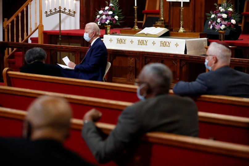 In this Monday, June 1, 2020, file photo, Democratic presidential candidate former Vice President Joe Biden listens as clergy members and community activists speak during a visit to Bethel AME Church in Wilmington, Delaware. (AP Photo/Andrew Harnik, File)