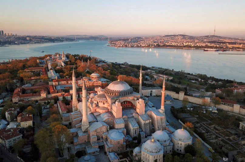 An aerial view of the Byzantine-era Hagia Sophia, bottom, one of Istanbul's main tourist attractions in the historic Sultanahmet district, April 25, 2020. The sixth-century building is at the center of a heated debate between conservative groups who want it to be reconverted into a mosque and those who believe the World Heritage site should remain a museum. (AP Photo)