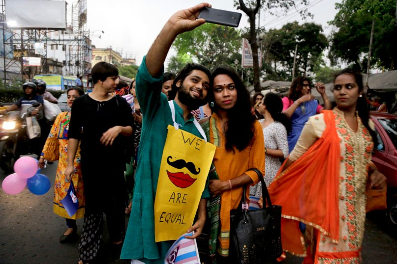 Transgender people and supporters participate in a Pride walk observing International Transgender Day of Visibility in Kolkata, India, on March 31, 2018. March 31 is observed as an annual event dedicated to celebrating transgender people and raising awareness on discrimination faced by transgender people worldwide. (AP Photo/Bikas Das)