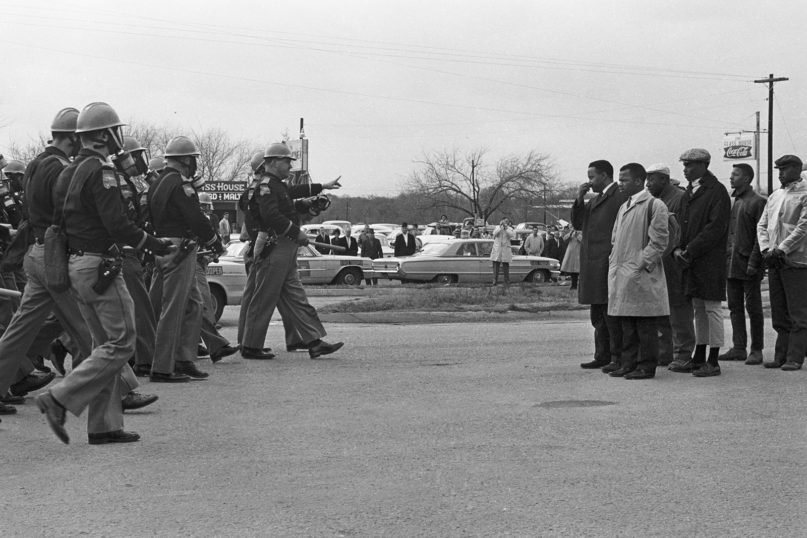 """John Lewis, center right, with fellow protesters on Bloody Sunday, March 7, 1965, in """"John Lewis: Good Trouble,"""" a Magnolia Pictures release. © Spider Martin. Photo courtesy of Magnolia Pictures"""