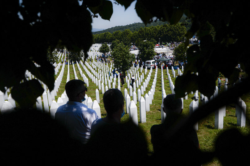Bosnians attend the funerals of nine newly found and identified male massacre victims in Potocari, near Srebrenica, Bosnia, Saturday, July 11, 2020. Mourners converged on the eastern Bosnian town of Srebrenica for the 25th anniversary of the country's worst carnage during the 1992-95 war and the only crime in Europe since World War II that has been declared a genocide. (AP Photo/Kemal Softic)