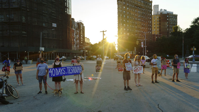 Jews have been gathering at Grand Army Plaza in Brooklyn every evening for the month leading up to Tisha B'Av to blow the shofar and cry out for justice on behalf of Black lives. Photo by Ari Beser