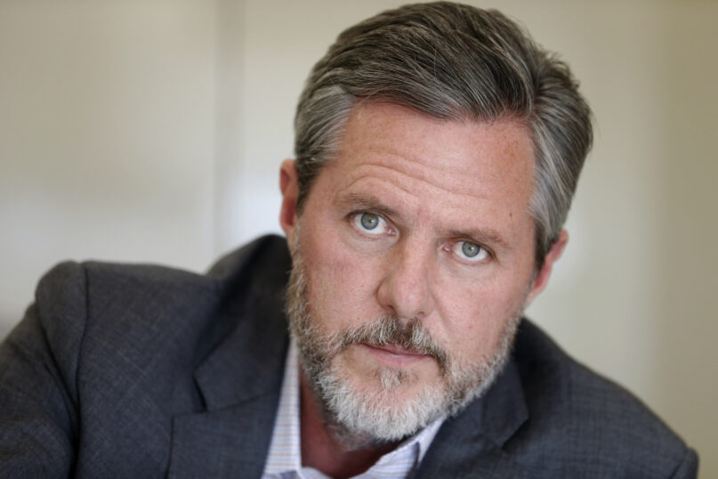 In this Nov. 16, 2016, file photo, Liberty University President Jerry Falwell Jr. pauses during an interview in his office at the school in Lynchburg, Virginia. On Aug. 25, 2020, Falwell said that he had submitted his resignation as head of the evangelical university. (AP Photo/Steve Helber, File)