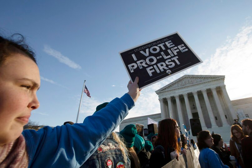 Anti-abortion demonstrators rally outside of the U.S. Supreme Court in Washington, Wednesday, March 4, 2020. (AP Photo/Jose Luis Magana)