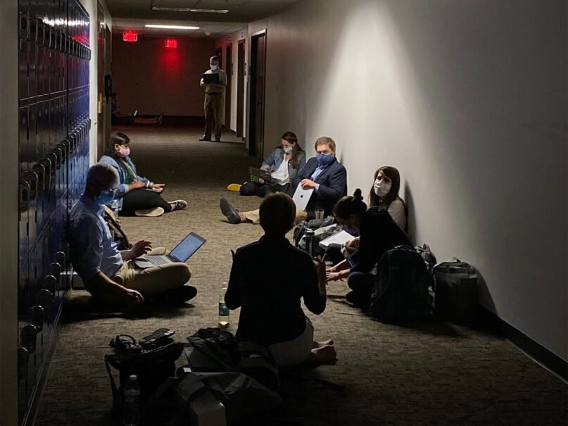 A Humanitarian & Disaster Leadership class continues from a basement at Wheaton College due to severe weather, on Aug. 10, 2020. Photo courtesy of Humanitarian Disaster Institute
