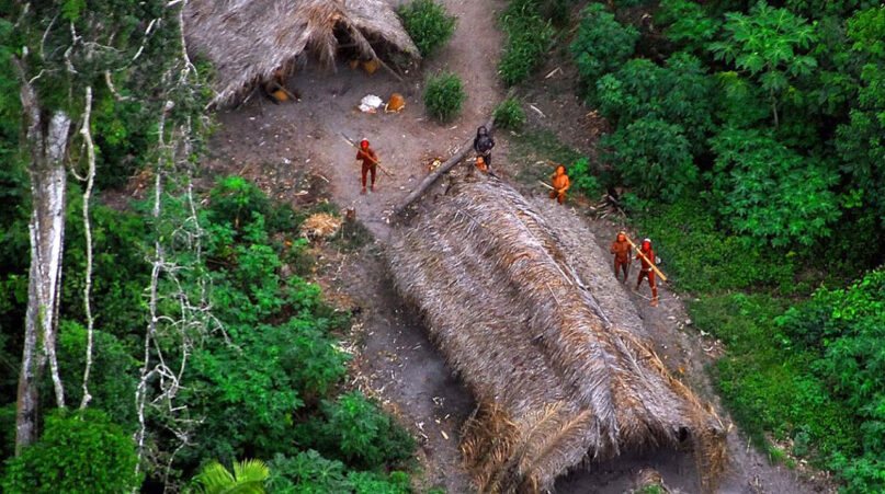 Uncontacted Indigenous people look up at an aircraft in the western Brazilian state of Acre in 2009. Photo by Gleilson Miranda/Government of Acre/Creative Commons