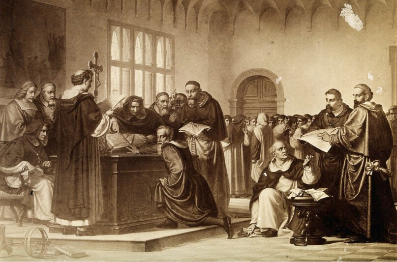 Galileo Galilei, kneeling center, at his trial by the Inquisition in Rome in 1633. Galileo pushes away the Bible. Image courtesy of Wellcome Library, London. Wellcome Images/Creative Commons CC BY 4.0