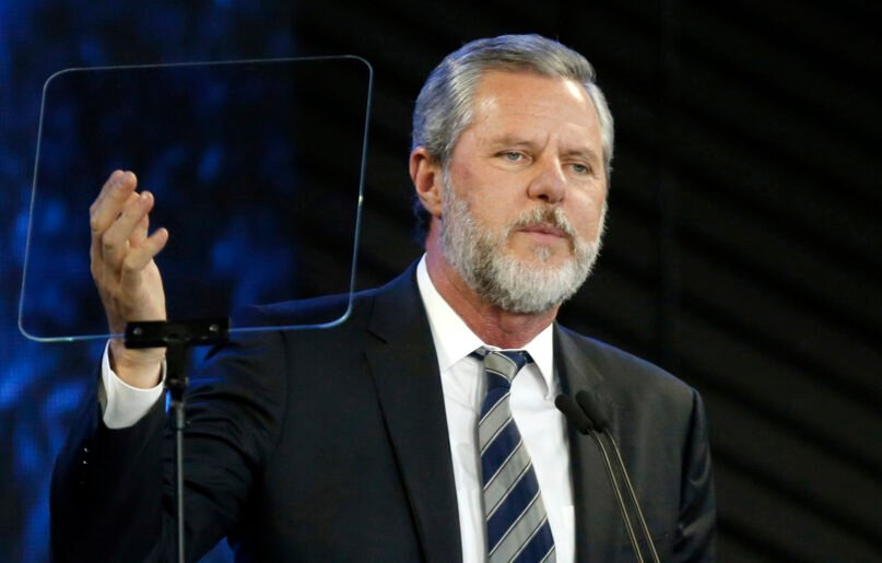 FILE - In this Nov. 28, 2018 file photo, Liberty University President Jerry Falwell Jr. speaks before a convocation at Liberty University in Lynchburg, Va. Falwell has agreed to take an indefinite leave of absence from his role as president and chancellor of Liberty University, the school announced Friday, Aug. 7, 2020. (AP Photo/Steve Helber, File)