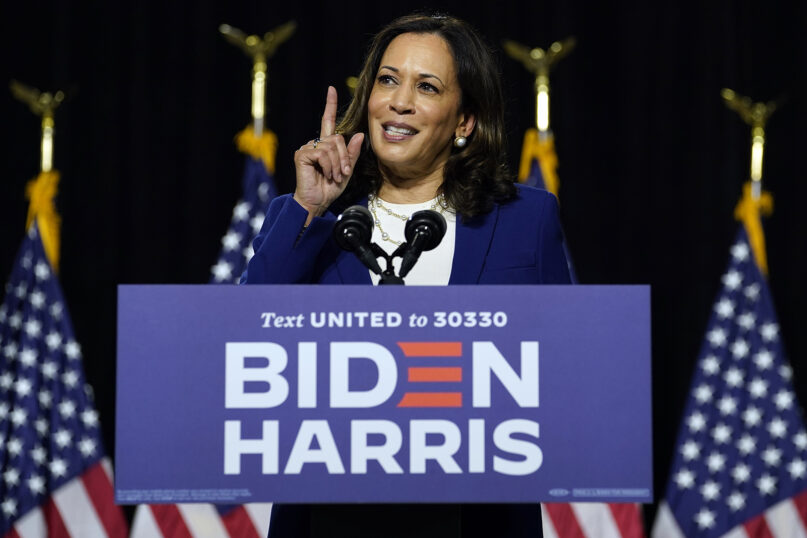 Sen. Kamala Harris, D-California, speaks after Democratic presidential candidate former Vice President Joe Biden introduced her as his running mate during a campaign event at Alexis Dupont High School in Wilmington, Delaware, on Aug. 12, 2020. (AP Photo/Carolyn Kaster)