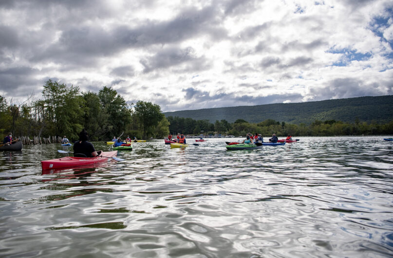 Pastor Jes Kast shares a message with the congregation of Faith United Church of Christ during a floating service at Bald Eagle State Park, Pennsylvania, on Aug. 30, 2020. RNS photo by Abby Drey