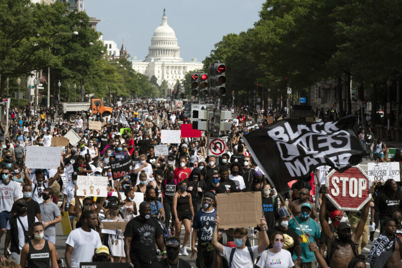 People walk on Pennsylvania Avenue during the March on Washington, Friday Aug. 28, 2020, on the 57th anniversary of the Rev. Martin Luther King Jr.'s