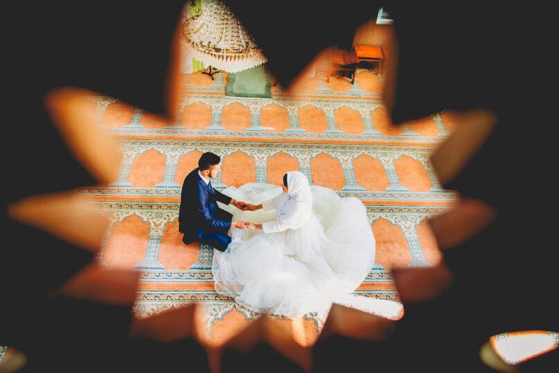 A Muslim couple poses for wedding photos. Photo by Ramiz Dedaković/Unsplash/Creative Commons