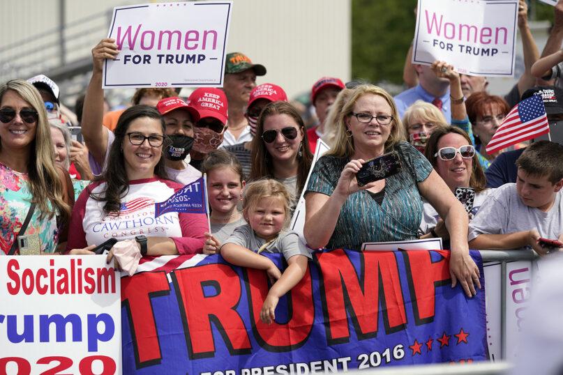 People wait to hear President Donald Trump speak at Asheville Regional Airport, Monday, Aug. 24, 2020, in Fletcher, North Carolina. (AP Photo/Evan Vucci)