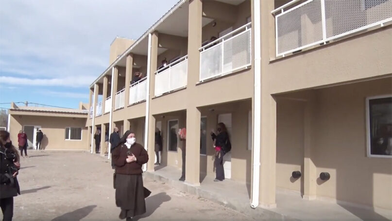 People tour a new housing complex for trans women after a ribbon cutting in Neuquén, Argentina, in August 2020. Video screengrab