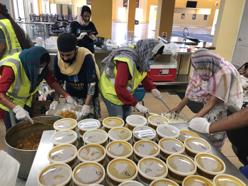 Volunteers prepare meals at the Sikh Gurdwara San Jose for distribution to those affected by Northern California wildfires, Sept. 6, 2020, in San Jose, California. Photo courtesy of United Sikhs