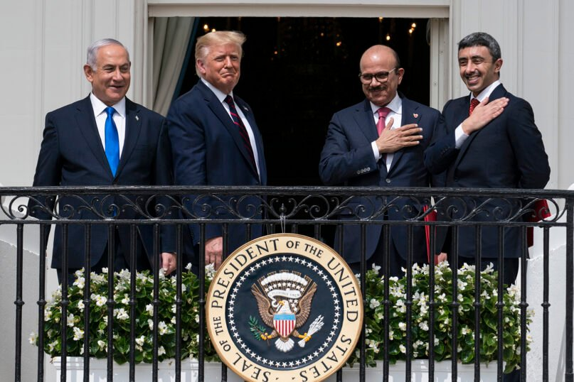 Left to right, Israeli Prime Minister Benjamin Netanyahu, U.S. President Donald Trump, Bahrain Foreign Minister Khalid bin Ahmed Al Khalifa and United Arab Emirates Foreign Minister Abdullah bin Zayed al-Nahyan react on the Blue Room Balcony after signing the Abraham Accords during a ceremony on the South Lawn of the White House on Sept. 15, 2020, in Washington. Jewish American voters have leaned Democratic for decades, but the GOP is still eyeing modest gains with the constituency in states where Trump could reap major benefits with even small improvements over his performance in 2016. (AP Photo/Alex Brandon)