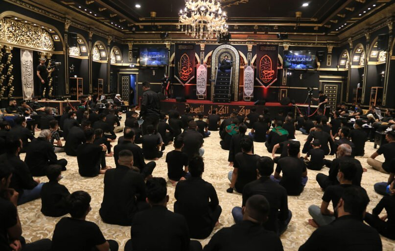 Shiite Muslims attend a mourning ritual during the Islamic month of Muharram, in the central shrine city of Karbala. (Photo by MOHAMMED SAWAF/AFP via Getty Images)