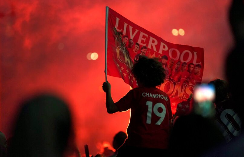 Liverpool supporters celebrate as they gather outside of Anfield Stadium in Liverpool, England, on June 25, 2020, after Liverpool clinched the English Premier League title. (AP photo/Jon Super)