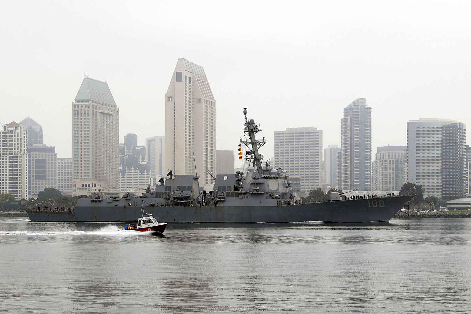 The USS Kidd passes downtown San Diego as it returns to Naval Base San Diego on April 28, 2020, seen from Coronado, California. (AP Photo/Gregory Bull)