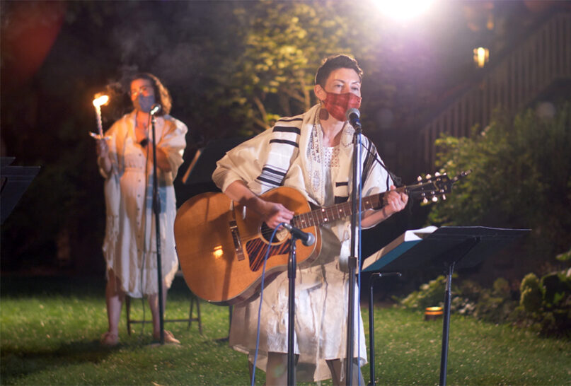 Rabbi Lizzi Heydemann, center, with musicians and singers from Mishkan Chicago perform songs and prayers of the High Holidays while outdoors. Photo courtesy of See3 Digital Events