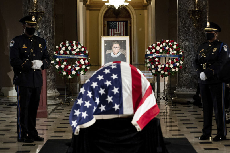 The flag-draped casket of Justice Ruth Bader Ginsburg lies in state in the U.S. Capitol on Friday, Sept. 25, 2020. Ginsburg died at the age of 87 on Sept. 18 and is both the first Jewish American and the first woman to lie in state at the Capitol. (Erin Schaff/The New York Times via AP, Pool)