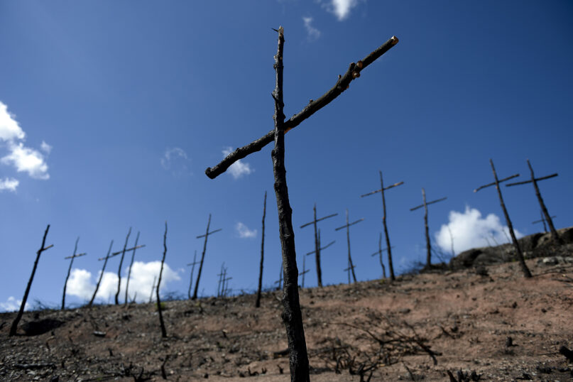 A churchgoer's thoughts on climate change may not have much to do with Christian teaching. (JOSEP LAGO/AFP via Getty Images)