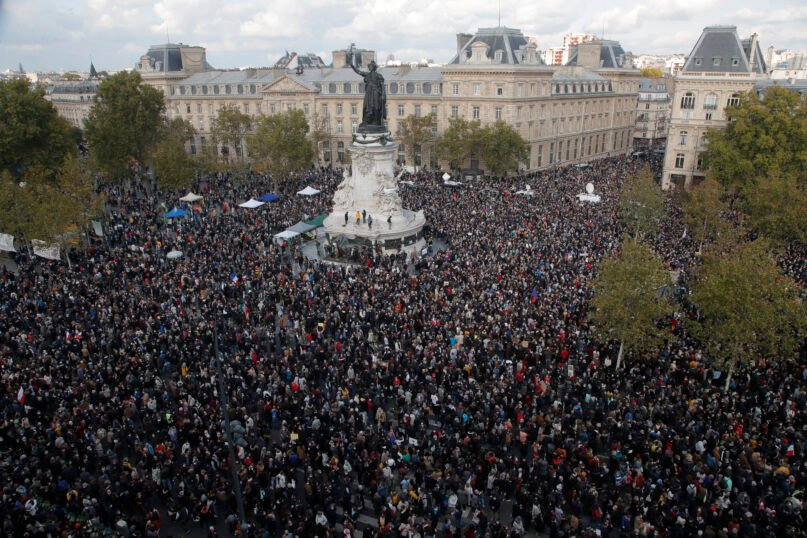 Hundreds of people gather on Republique Square during a demonstration Oct. 18, 2020, in Paris. Demonstrations around France have been called in support of freedom of speech and to pay tribute to a French history teacher who was beheaded near Paris after discussing caricatures of Islam's Prophet Muhammad with his class. Samuel Paty was beheaded on Oct. 16 by an 18-year-old Moscow-born Chechen refugee, who was later shot dead by police. (AP Photo/Michel Euler)
